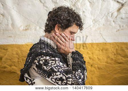 Andujar SPAIN - September 7 2014: Spainish bullfighter Miguel Abellan totally focused moments before leaving to fight in Bullring of Andujar Spain
