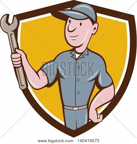 Illustration of a repairman handyman worker wearing hat holding spanner wrench looking to the side set inside shield crest done in cartoon style.