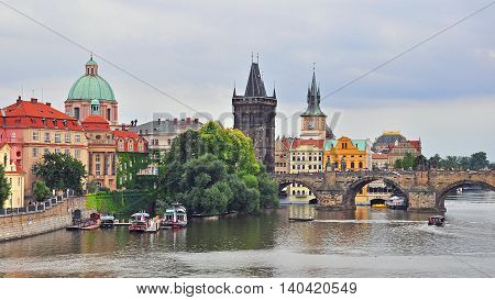 PRAGUE CZECH REPUBLIC - AUGUST 1: View of the Karlov bridge in city centre of Prague on August 1 2014. Prague is the capital and largest city of the Czech Republic.