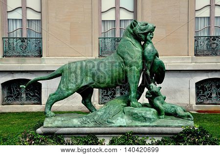 Newport Rhode Island - July 17 2015: 1873 Sculpture of a Lion holding a bird in its mouth at 1901 The Elms summer mansion of coal baron Edward Berwind