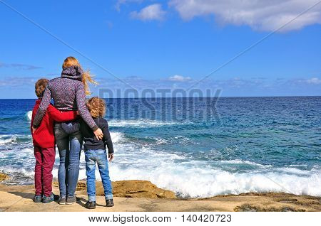 Back view of Family at the sea