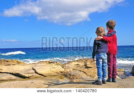 Two little friends at the Mediterranean sea