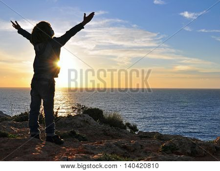 Silhouette of a boy on the sunset