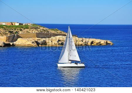VALLETTA MALTA - FEBRUARY 16: Sail boat in harbor of Maltese islands in Mediterranean sea on February 16 2014. Malta is a southern European country in the Mediterranean Sea.