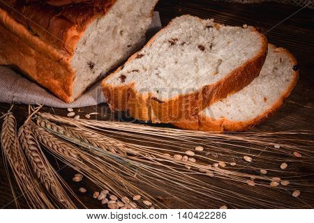sliced white buns and ears of wheat close