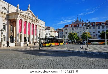 LISBON PORTUGAL - DECEMBER 21: National theatre building on the square of Dom Pedro IV on december 21 2013. Lisbon is a capital and the largest city of Portugal.