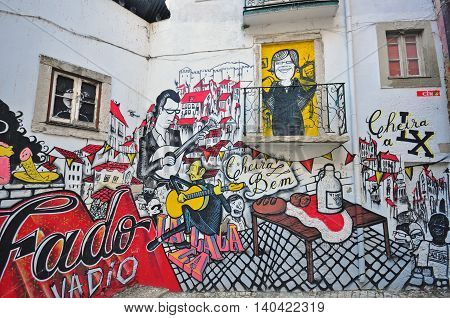 LISBON PORTUGAL - DECEMBER 21: Graffiti of traditional portuguese fado on the street of Lisbon on December 21 2013. Lisbon is a capital and the largest city of Portugal.