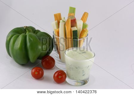 Useful summer snack: vegetables and yogurt sauce with herbs.