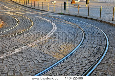 The winding road with the tram lines
