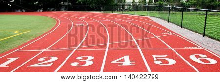 The start line on a six lane red track.
