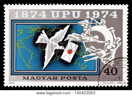 HUNGARY - CIRCA 1974 : Cancelled postage stamp printed by Hungary, that shows carrier pigeon, world map and emblem.