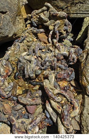 Old corroded chain for tying boats in the harbor.
