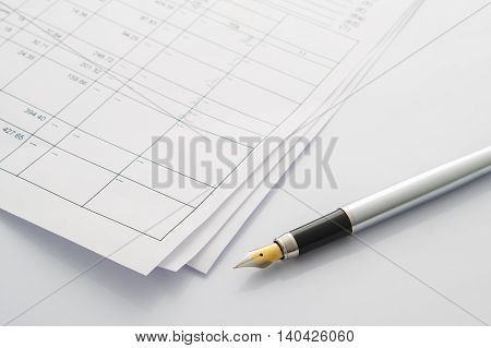 Feather Pen Is Close To The Business Transactions. On Paper, The Number And The Table.