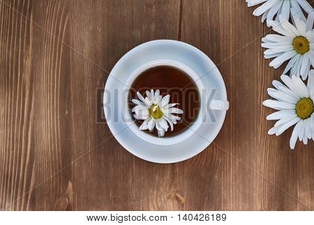 Tea in a white cup of herbal tea of chamomile