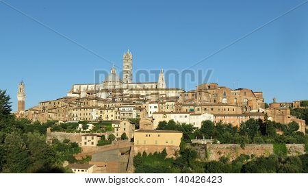 Siena Italy - medieval city centre with town hall tower cathedral and Santa Maria della Scala former hospital