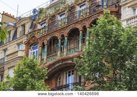 PARIS, FRANCE - MAY 12, 2015: This is a fragment of an apartment house Lavirotte built in the Art Nouveau style.