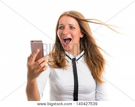 Happy young woman exercising photographed using a mobile phone camera