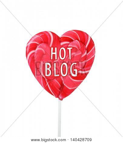 Heart shaped lollipop isolated on white. Hot blog concept