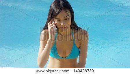Attractive young woman chatting on a cellphone