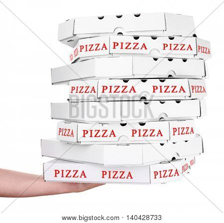 Hand holding pizza boxes isolated on white