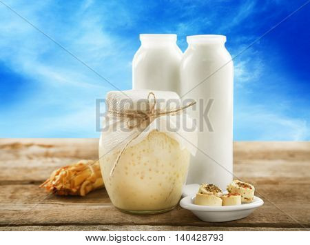 Conception of dairy food on table on blue sky background