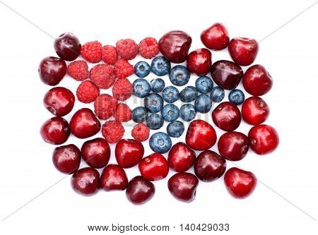 Isolated heap of cherry, blueberry and raspberry on a white background
