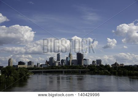Minneapolis Skyline in the Summer with the Mississippi river.