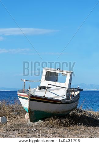 old boat on the sea background and blue sky