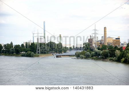 Various industrial facilities and power plants located on a river.