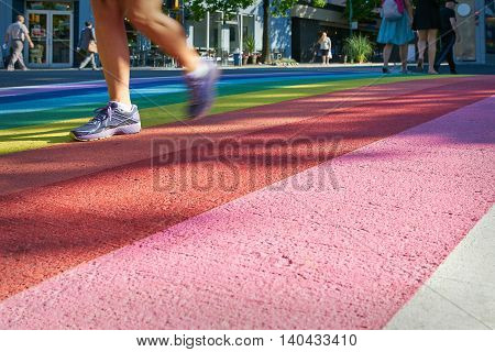 Pride Rainbow Crosswalk, Vancouver. Pedestrians using the rainbow colored crosswalk in downtown Vancouver.