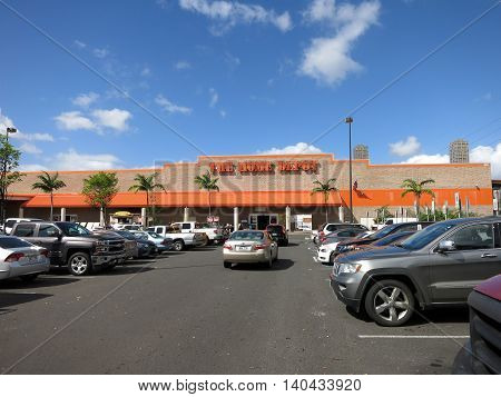 Honolulu HI USA - August 4 2015: Oahu Home Depot parking lot filled with cars. Founded in 1978 The Home Depot is a retailer of home improvement and construction products and services. It is the largest home improvement retailer in the USA.