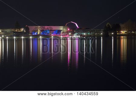 2016 JULY 29: The National Museum of Australia lights reflecting in Canberra's lake