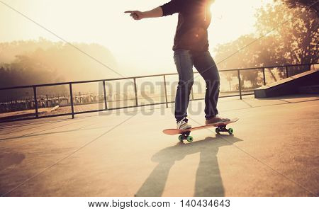 one young woman skateboarder skateboarding at skatepark