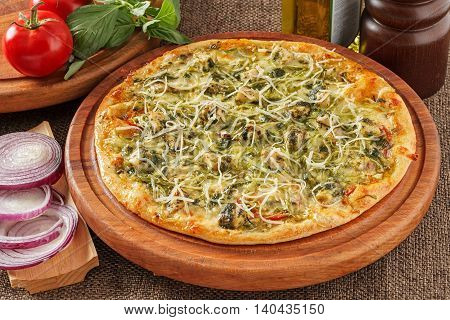 Pizza with spinach, tomatoes, pepper and cheese