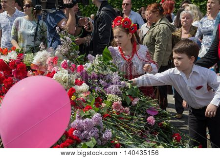 Kiev Ukraine - May 09 2015: Children laid flowers at the monument to fallen soldiers Second World War