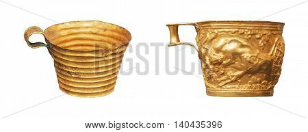 antique two gold cup isolated on the white background