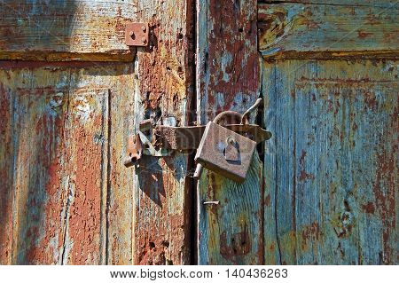 Rusty Lock On Old Wooden Gate