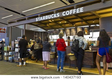 Indianapolis - Circa July 2016: Starbucks Coffee AIrport Location. Starbucks is an American Retail Coffee Chain VI