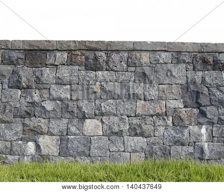 Grass and grey block wall