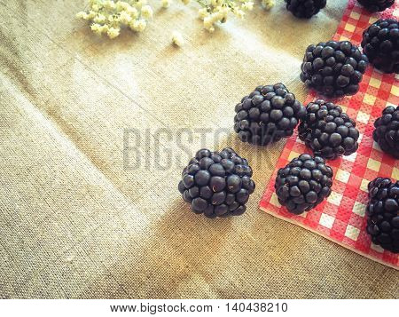 Blackberries on the table in vintage style filter with copy space