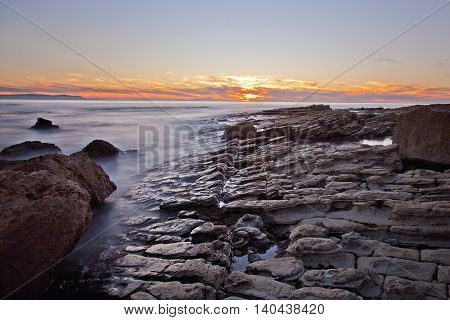 Sunset on the rocks of Rancho Palos Verdes, California