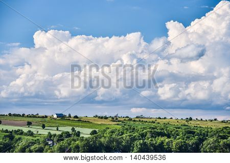 Storm clouds over a barn in a field