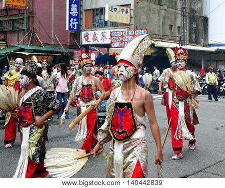 Dancers With Painted Facial Masks