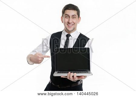 Businessman man with a laptop in hand in a white shirt . Displays in the monitor and smiling.