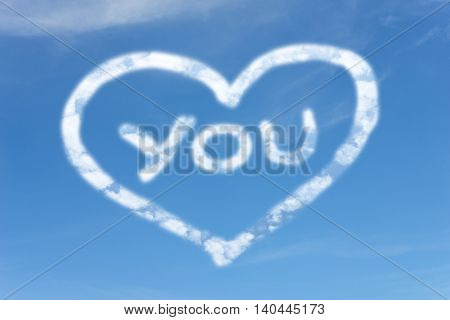 White clouds in the sky with symbol LOVE YOU. Abstract Love