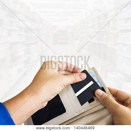 Hands Pull Credit Card Out Of Wallet With Space Area Background
