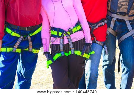 The women and men is ready to belay a climber