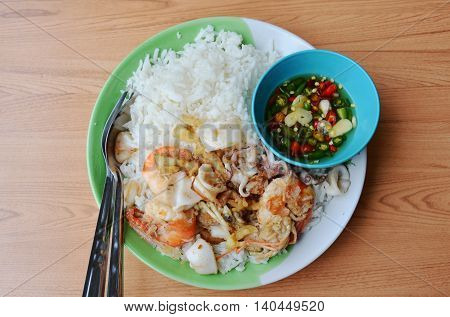 fried prawn and squid with garlic on rice