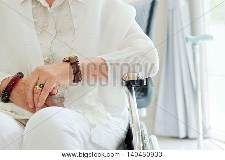 image of elderly woman in wheelchair background