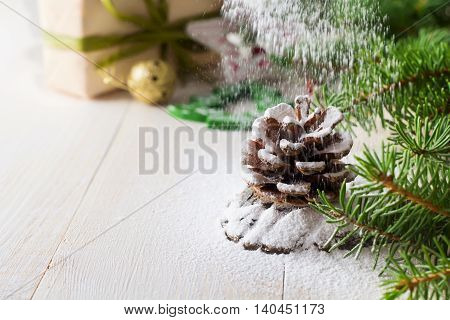 Christmas composition with pinecone and fir-tree. Selective focus.